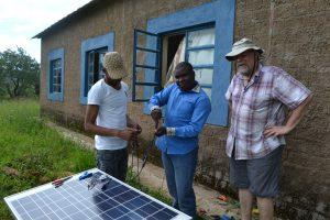 HT fixing solar panel at Kabila School
