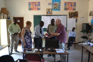 Handing over the first Raspberry Pi computer to Siavonga District Education Board Secretary