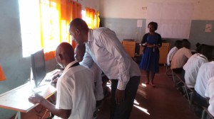 Mr Kabila working with students