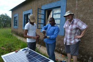 HT fixing solar panel at Kabila School