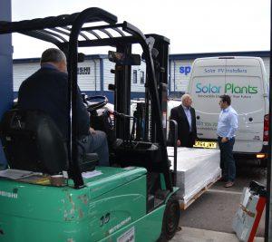 Director of SolarPlants handing over panels