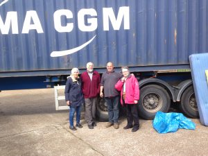 Lyn, Wendy, Howard and Paul in front of container