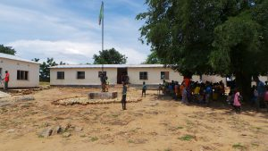 children under tree at Siakalinda School