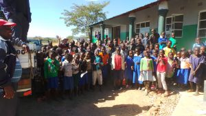 school children greeting us