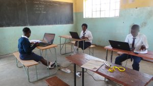 pupils with laptops