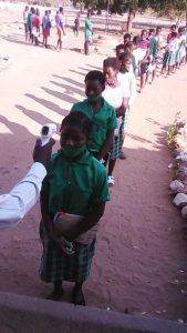 pupils at Bbakasa school lining up for temperature testing
