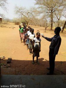 testing temperature at Dambilo school