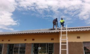 men at work on roof